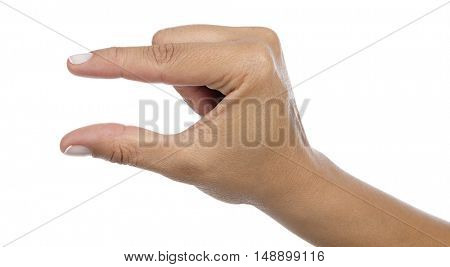 Female caucasian hand gesturing a small amount isolated on white background.