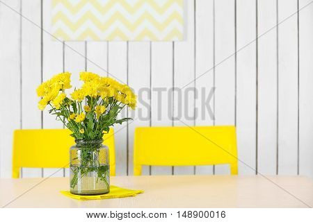 Bouquet of fresh yellow flowers on table