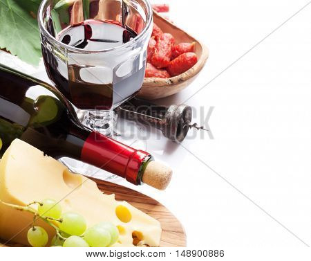 Red wine, grape, cheese, bread and sausages. Isolated on white background with copy space