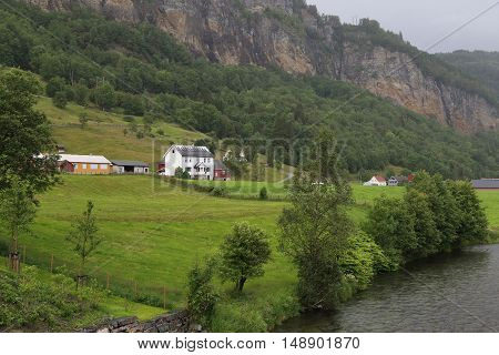NORHEIMSUND, NORWAY - JULY 2, 2016: This is a typical small settlement along the river Steinsdalselva.