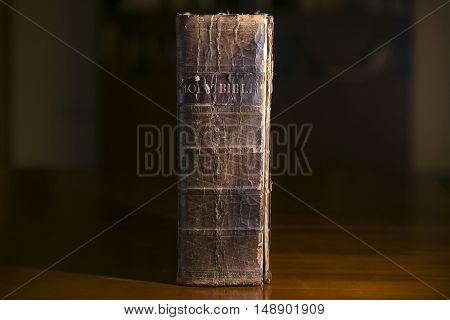 Old Bible Resting on a Desk in a Library