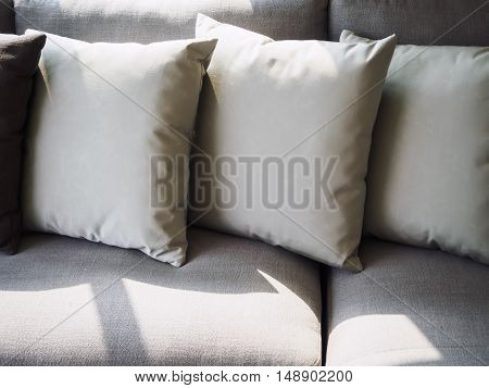 Pillows on sofa room interior decoration with morning light