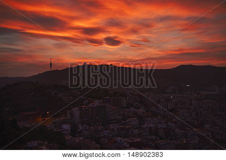Dramatic shot of Barcelona skyline and downtown under sunset sky