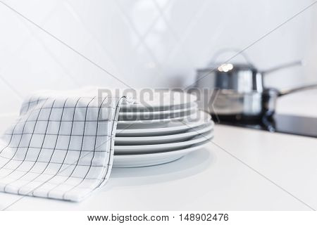 White plates with Hand towel Blurred Home Kitchen Interior