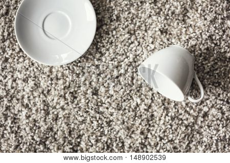 Cup and saucer on Carpet floor Household object