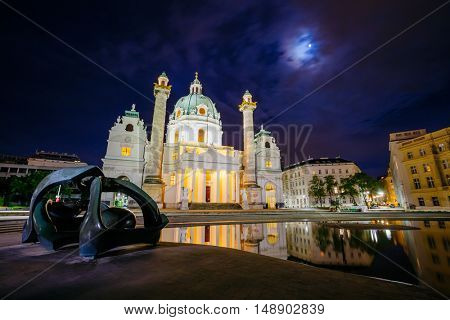 Magical evening view of the St. Charles Church (Karlskirche). Historical scene, famous tourist attraction. Location place Karlsplatz in Vienna. Austria, Europe. Artistic picture. Beauty world.