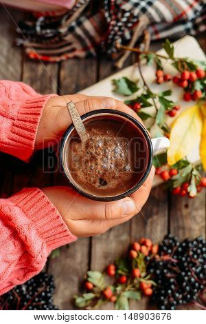 Woman Holding Cup Of Hot Chocolate. Hot Chocolate In Wooden Tabl