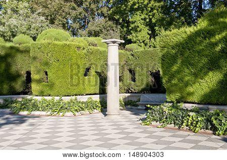 Column and garden. Picture taken in Cecilio Rodriguez's Garden Retiro Park Madrid Spain