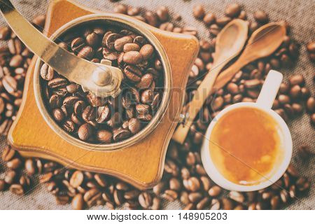 Closeup coffee beans on coffee grinder. You can apply for coffee background coffee backdrop coffee wallpaper coffee with text and everything about coffee background concept.