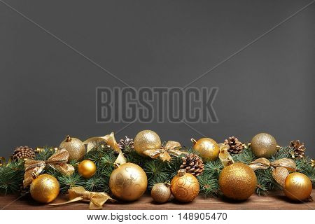 Christmas composition with balls and decorations on grey background