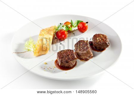 Beef Medallions with Roasted Vegetable Strudel