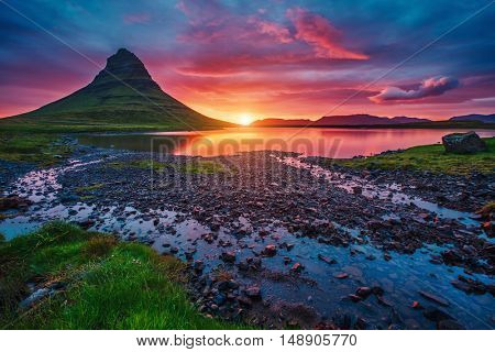Majestic evening with Kirkjufell volcano the coast of Snaefellsnes peninsula. Popular tourist attraction. Dramatic and picturesque scene. Location place Kirkjufellsfoss, Iceland, Europe. Beauty world.