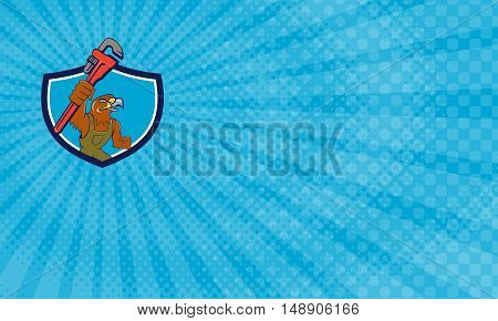 Business Card showing Illustration of a hawk mechanic raising up pipe wrench spanner set inside shield crest on isolated background done in cartoon style.