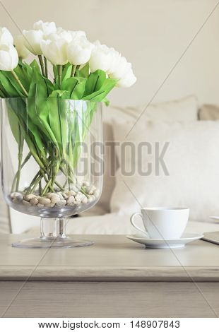 Coffee cup on table with Flowers Sofa Pillows Home decoration background