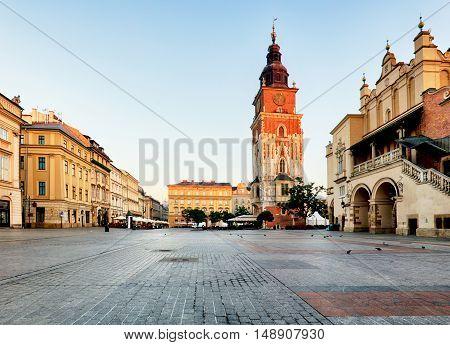 Tower in Krakow square Poland at sunrise