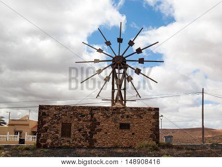 OLHistoric wooden wind mill in Valles de Ortega with twelve wings on the Spanish island Fuerteventura one of the Canary islands in the Atlantic Ocean belonging to Spain