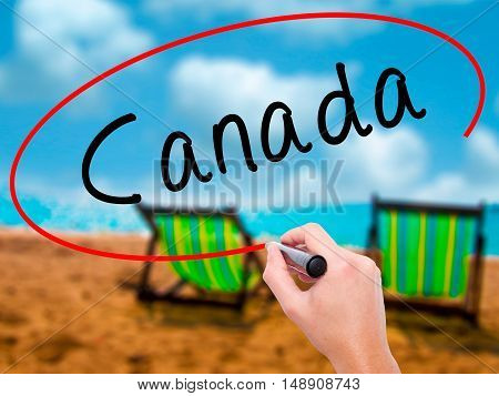 Man Hand Writing Canada With Black Marker On Visual Screen