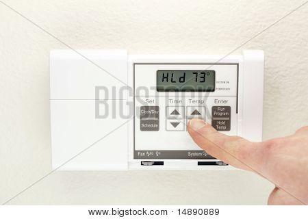 Mano en termostato