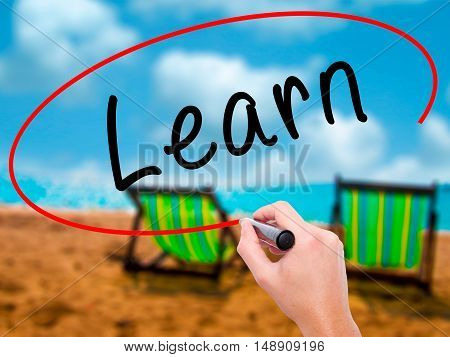 Man Hand Writing Learn With Black Marker On Visual Screen