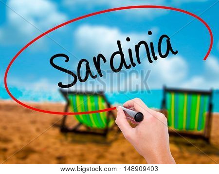 Man Hand Writing Sardinia  With Black Marker On Visual Screen