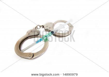 Handcuffs and syringe