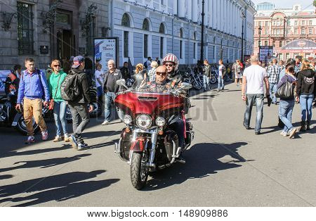 St. Petersburg, Russia - 12 August, A pair of biker on a motorcycle,12 August, 2016. The annual International Festival of Motor Harley Davidson in St. Petersburg Ostrovsky Square.