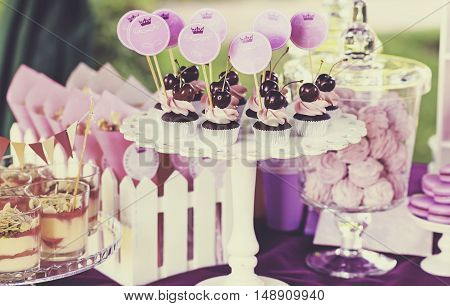 Delicious sweet buffet with cupcakes, tiramisu glasses and other desserts. Creative instagram effect