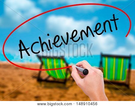 Man Hand Writing Achievement With Black Marker On Visual Screen
