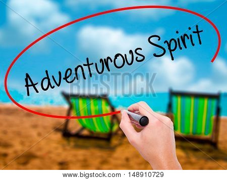 Man Hand Writing Adventurous Spirit With Black Marker On Visual Screen