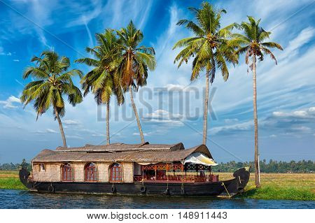 Kerala travel tourism background - houseboat on Kerala backwaters. Kerala, India