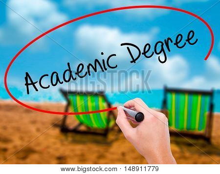 Man Hand Writing Academic Degree With Black Marker On Visual Screen