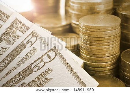 gold coin money and dollar bill. finance and banking concept.