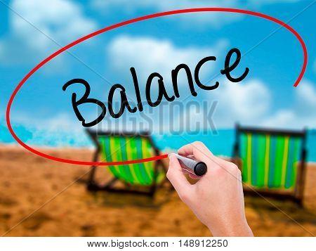 Man Hand Writing Balance With Black Marker On Visual Screen