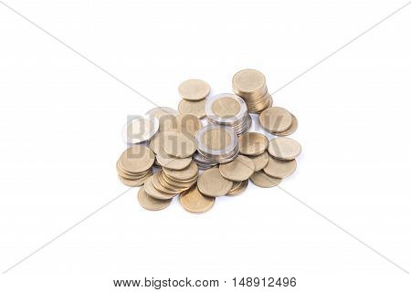 Closeup gold coin money isolated on white background. finance and banking concept.