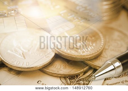 gold coin money and credit card. finance and banking concept.
