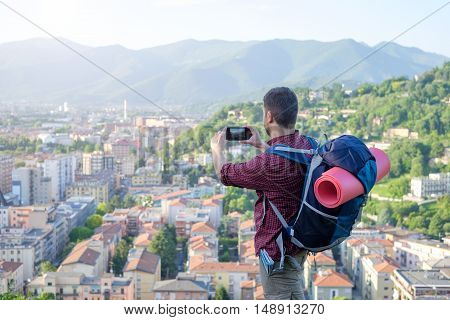 Tourist Taking Picture Of European City Landscape