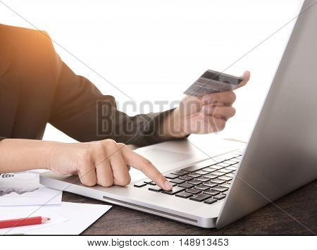 Businessman hands holding credit card with using computer laptop. concept online shopping