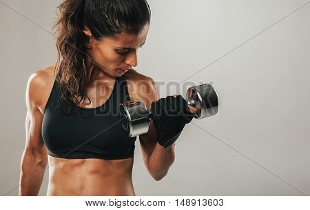 Close Up Of Woman Curling Dumbbell