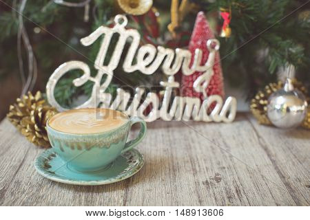 Vintage tone of Hot Coffee cup on vintage table /Christmas holidays background