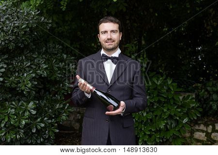 Waiter serving a luxury frozen champagne bottle