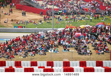 Spectators on tribunes on The Formula 1 Grand Prix