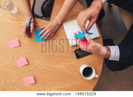 Brainstorming Session With Post It Notes On Table