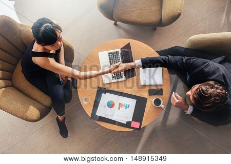 Business Colleagues Shaking Hands On Deal
