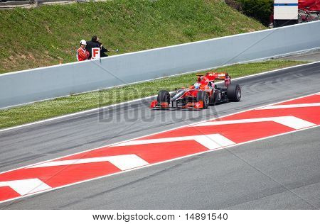 "The racing car leaves lock-up garage during The Formula 1 Grand Prix at autodrome ""Catalunya Montmel"