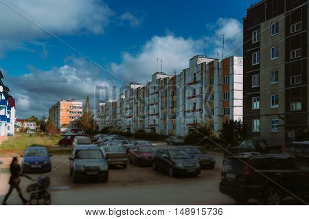Clouds rush over the old multi-apartment residential buildings