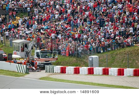 The racing car take off from line in sandy zone during The Formula 1 Grand Prix at autodrome