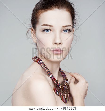 Beautiful Woman  In A Necklace. Beautiful Spa Model Girl With Perfect Fresh  Skin. Youth And Skin Ca