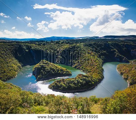 Meanders of river Uvac gorge on sunny day, southwest Serbia.