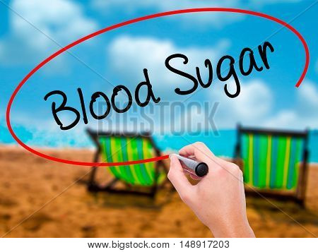 Man Hand Writing Blood Sugar With Black Marker On Visual Screen