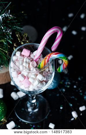 White And Pink Marshmallows In A Glass On The Dark Wooden Table